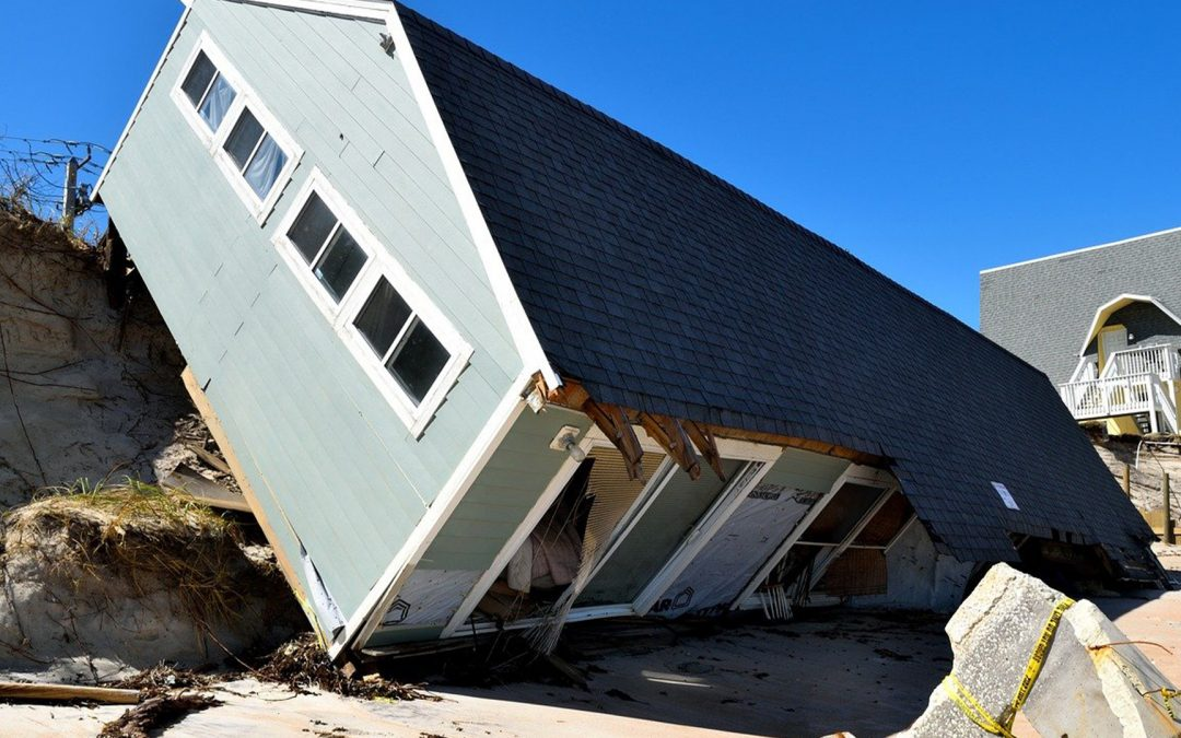 a house that fell off a cliff due to an hurricane