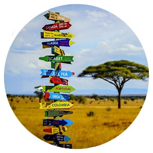 a sign in africa with lots of locations marked on it
